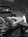 1930s-1940s Man's Hand Pushing Price Buttons on Cash Register