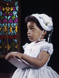 1960s Religious Little African American Girl Wearing White Hat and Dress Holding Bible Standing