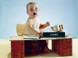 1960s Baby Businessman Sitting at Toy Desk Loans Sign Wearing Eyeglasses