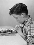 1950s Boy Child Praying at Table Dinner