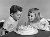 1940s-1950s Two Children Blowing Out Birthday Candles