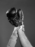 1950s Gloved Hand of Winner of Boxing Match Being Held Up by Referee