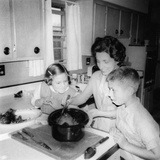 Mom Prepares Dinner with the Kids Watching  Ca 1962