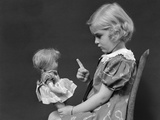 1930s Little Blond Girl Scolding Her Doll Pointing Finger