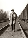 1930s Great Depression Era Man Homeless Hobo Walking Down Railroad Tracks