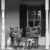 Couple Man Woman Sitting on Porch in Rocking Chairs Holding Newspapers Up Hiding their Faces