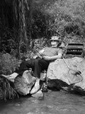 1950s Lazy Fisherman Lying Back on Rock with Hat Pulled over Eyes Fishing in Creek
