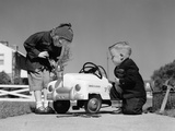 1950s Boy and Girl Playing at Repairing Toy Car