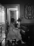1920s Woman Pianist Sitting Playing Piano