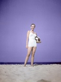 1950s Full Length Portrait Woman in Bathing Suit Swim Standing on Sand Holding Beach Ball