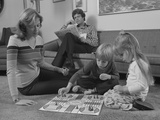 Family Mother Kids Playing Board Game Living Room Floor Father Reading Newspaper