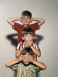 Boys Posing as Three Wise Monkeys See No Evil Hear No Evil Speak No Evil