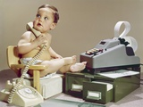 1960s Business Baby Sitting in Chair Holding Telephone with Calculator Adding Machine