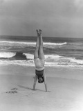 1930s Woman Doing Handstand on Beach Upside Down Exercise