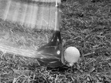1960s Moving Driver Golf Club Hitting Ball on Tee in Grass