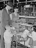 Family of 4 Inside Supermarket Father Pushing Cart Mother 2 Kids