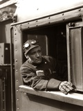1920s-1940s Railroad Train Engineer Looking Out Window of Locomotive Cab Driving the Steam Engine