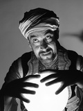 Scary Fortune Teller Man with Hands on Lighted Crystal Ball Wearing Turban