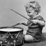 1930s Toddler Boy Playing Toy Drum