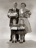 1940s-1950s Family Carrying Christmas Gifts Wrapped Presents
