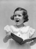 1930s Little Brunette Girl Singing Holding Songbook