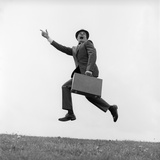 1960s Businessman Carrying a Briefcase Running Yelling and Jumping in the Air