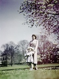 1940s Woman Mother Girl Daughter Standing in Blossoming Spring Landscape