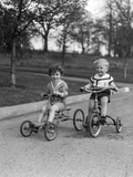 1930s Two Boys Riding Tricycles