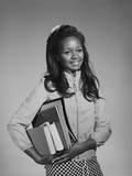 African-American Teen Girl Carrying School Books