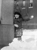 1930s Boy Peeking around Side Building Throwing a Snowball Winter