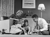 1950s Family of 4 Gathered in Living Room Playing with Letter Blocks