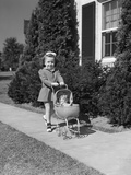 1940s Little Girl Walking Pushing Her Doll in Antique Woven Wicker Stroller on Sidewalk