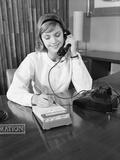Secretary Receptionist Talking on Telephone Writing into Desk Calendar