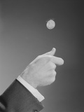 Male Hand Tossing Flipping a Coin