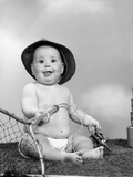 1960s Baby Girl Wearing Fishing Hat Holding Net and Reel Fishing Gear