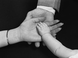 Hands of Family Man Woman Child Mother Father Baby