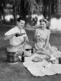 Man Woman Couple Having a Summer Picnic Outdoors Drinking Beer
