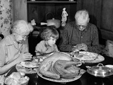 1950s-1960s Little Girl Looking at Turkey Sitting Between Grandmother and Grandfather