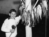 1950s Smiling Boy Proudly Displaying His Fish Catch