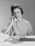 Smiling Woman Secretary Talking on Telephone Information Desk