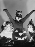 1950s 3 Children in Costumes around a Carved Pumpkin Jack-O-Lantern
