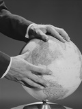 Male Hands Holding Earth Globe