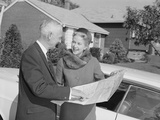 Senior Man and Woman by Car Looking at Map