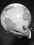 Mans Hand Holding Globe of the World