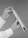 Male Hands Holding a Slide Rule Measure