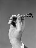 1960s-1970s Hand Close-Up Holding About to Throw a Sharp Pointed Dart