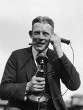 1920s Portrait of Businessman Talking on Candlestick Phone Smoking Cigar Office Indoor