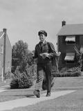 Postal Mailman Walking Suburban Street Wearing Uniform Delivering Mail