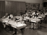 1960s Elementary Classroom Children at Desks Writing Studying