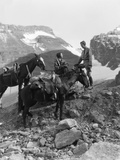 Couple Man Woman Wearing Riding Gear Jodhpurs Boots Spurs Sitting Standing on Large Rock